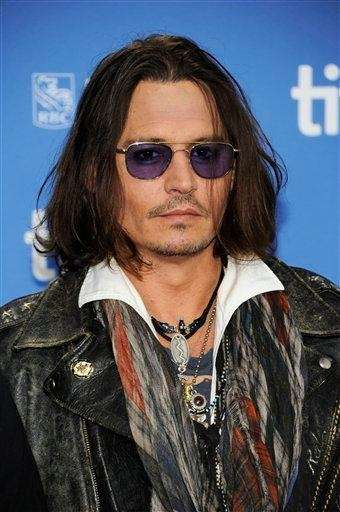 Johnny Depp participates in a photo call and