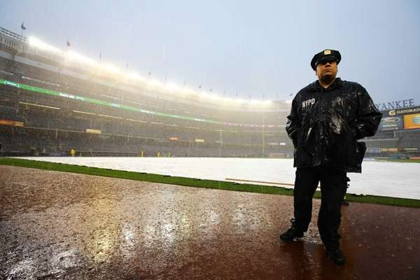 NYPD officer Angel Maysonet stands on the field