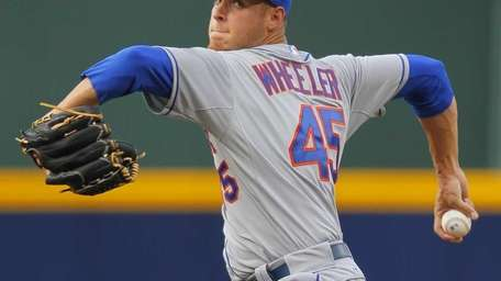 Zack Wheeler delivers a pitch in the first