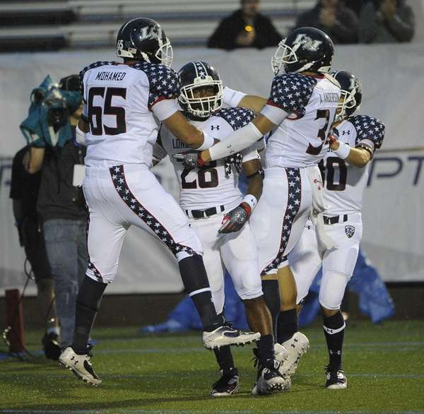 Long Island team running back William Stanback, center,