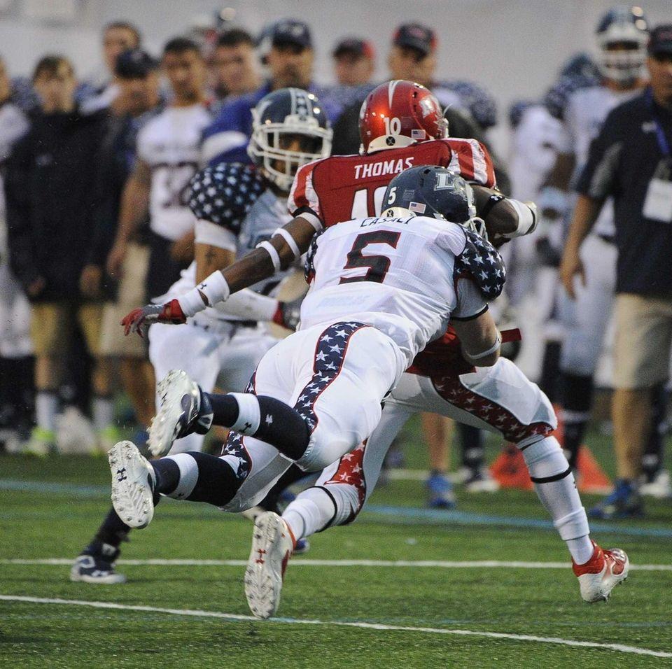 Long Island team middle linebacker Steven Casali tackles