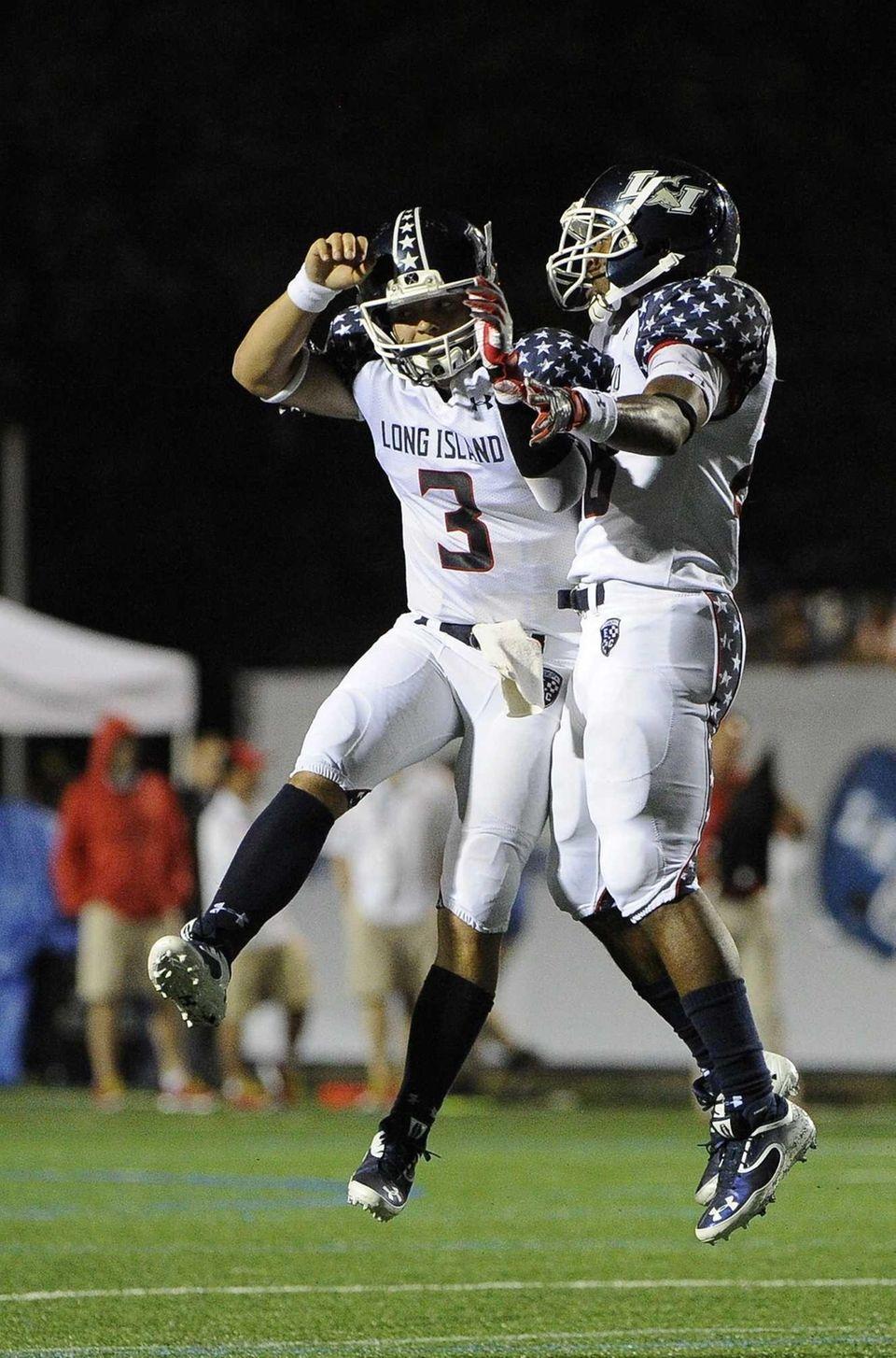 Long Island team quarterback A.J. Otranto, left, celebrates