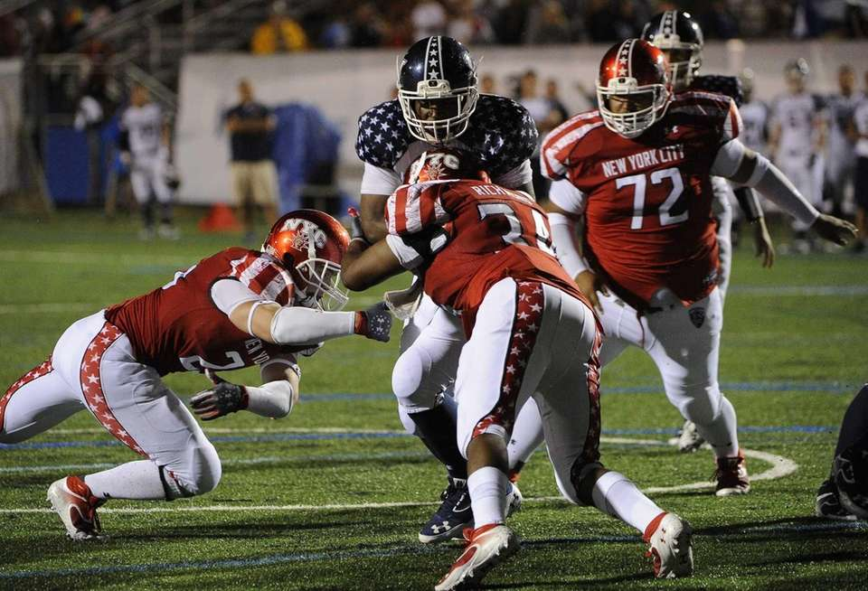 Long Island's Tyler Fredericks carries the ball against
