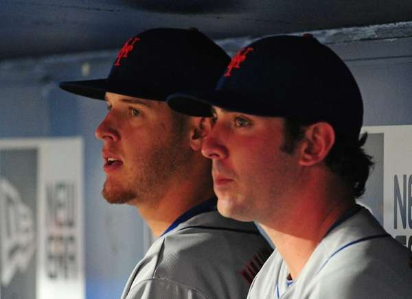 From left, Zack Wheeler and Matt Harvey watch