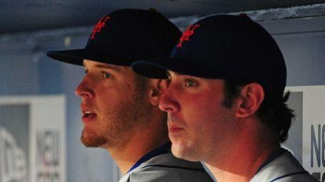 From left, Zack Wheeler and Matt Harvey watch