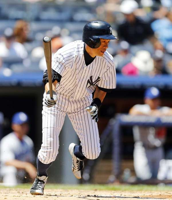 Ichiro Suzuki of the Yankees follows through on