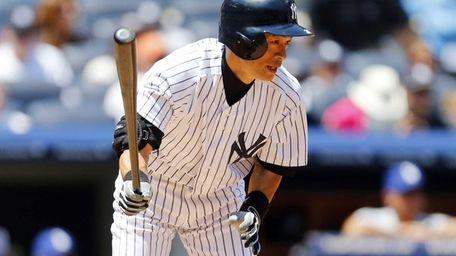 Ichiro Suzuki of the Yankees follows through on