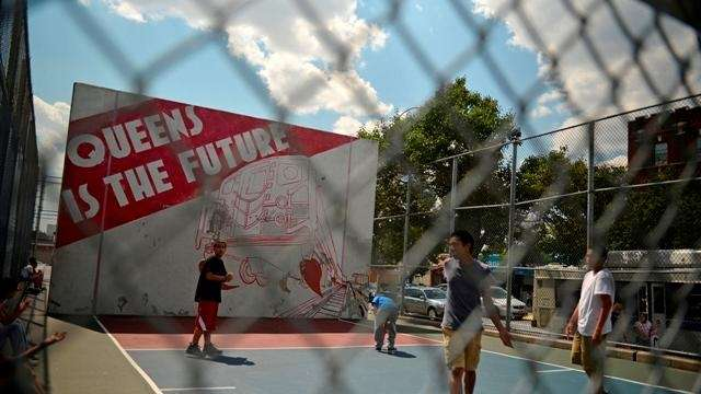 Children play on a handball court at 80th