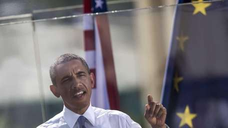 President Barack Obama gestures as he holds a