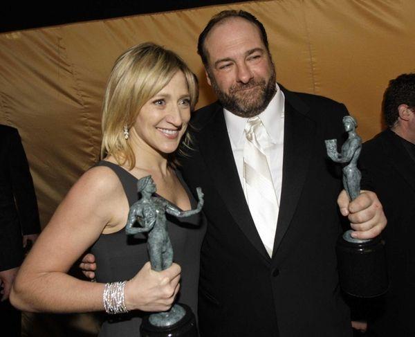 Edie Falco and James Gandolfini hold their awards