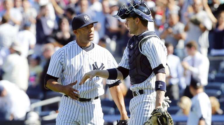 Mariano Rivera and Chris Stewart of the Yankees