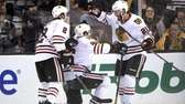 Duncan Keith, Michal Handzus and Brandon Saad of
