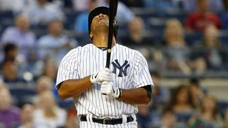 Vernon Wells reacts to a strike against the