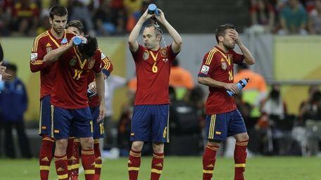 Spain's Gerard Pique, Pedro Rodriguez, Andres Iniesta and