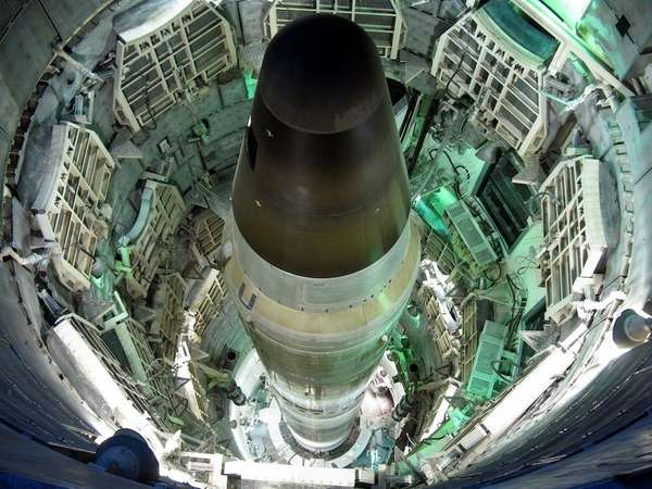 A Titan II missile in the launch duct