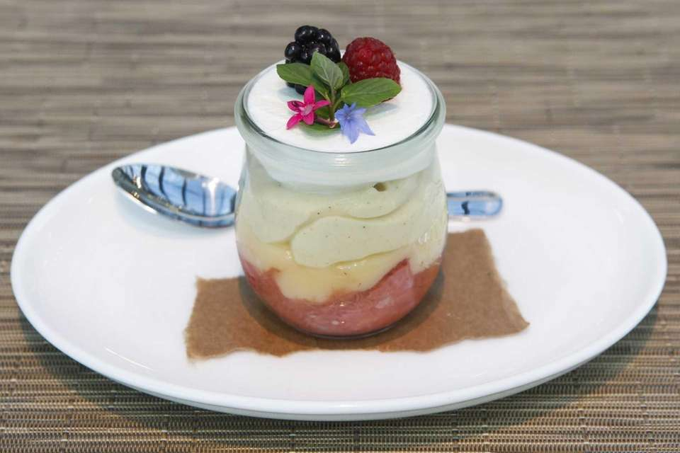 A lemon parfait is served with strawberry rhubarb