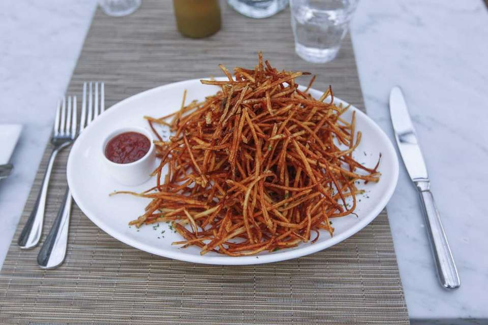 A plate of matchstick potatoes, also known as