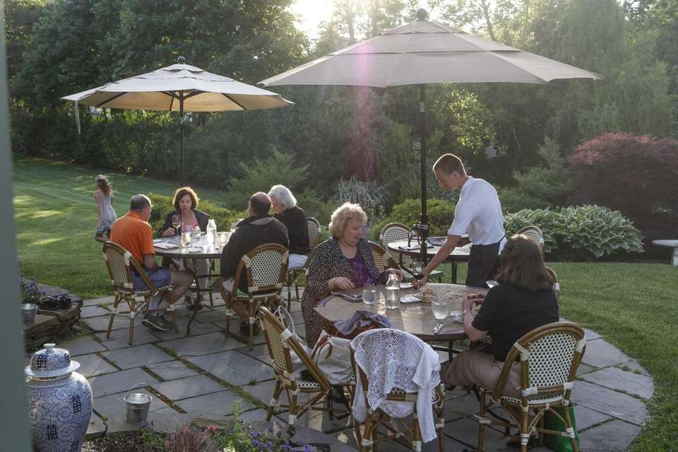 Patrons dine outside on the patio at Jedediah