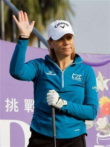 Annika Sorenstam greets fans before teeing off during
