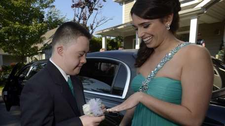 Christopher Bartley places a corsage on Brooke DiPalma's