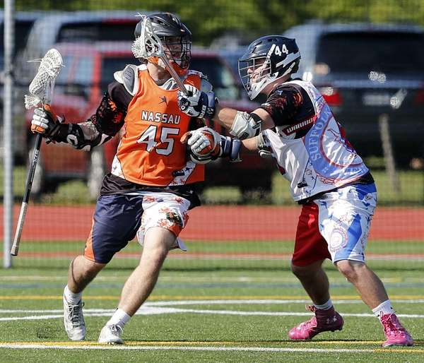 Nassau's Patrick McCormick of Hicksville, left, is marked