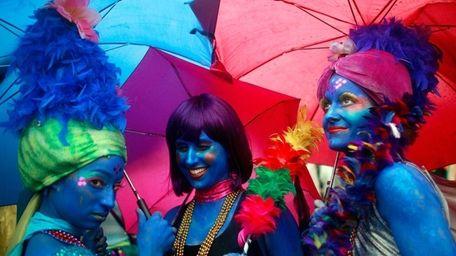 Women dressed as mermaids prepare to march before