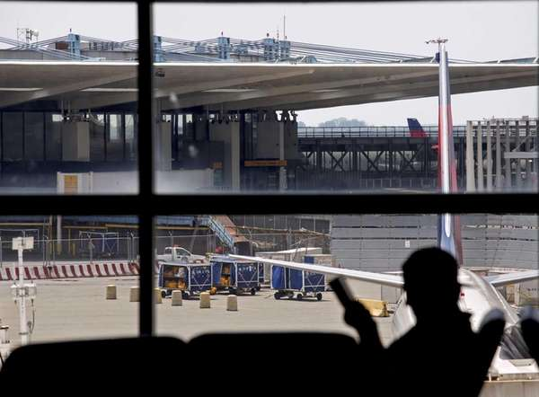 With the shuttered Terminal 3 in the background,
