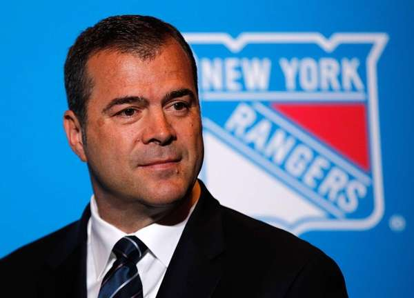 Alain Vigneault speaks to the media after being
