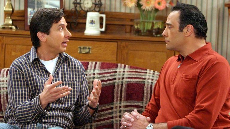 Robert (Brad Garrett, right) gets mad at Ray