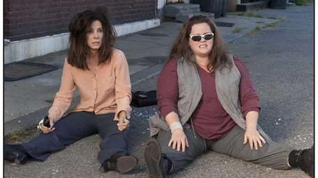 From left, Sandra Bullock and Melissa McCarthy in
