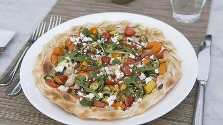 Flatbread with seasoned vegetables and Catapano goat cheese