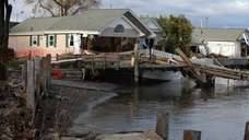 Homes along Beach Road in Stony Point suffered
