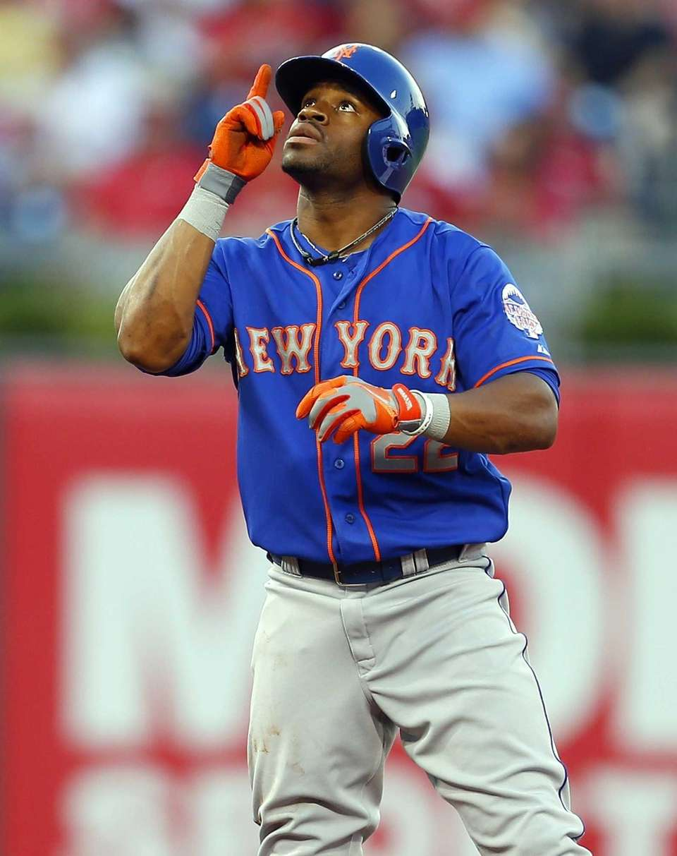 Eric Young of the Mets gestures after hitting