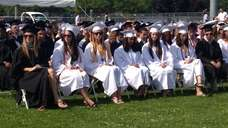 Students wait for the graduation ceremony to begin