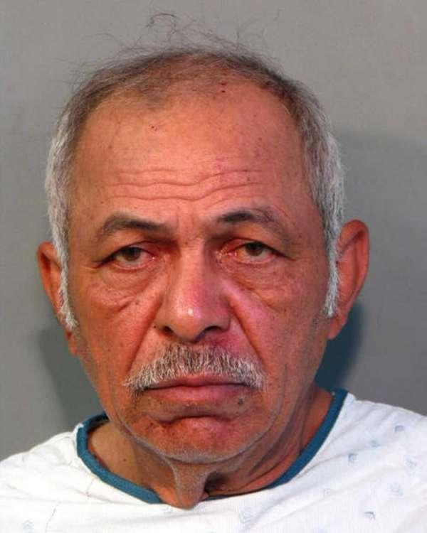 Luis Andrade, 56, of New Cassel, is charged