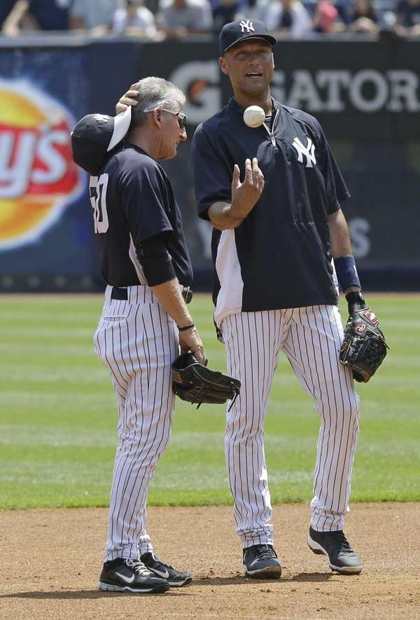 New York Yankees' Derek Jeter, right, talks with