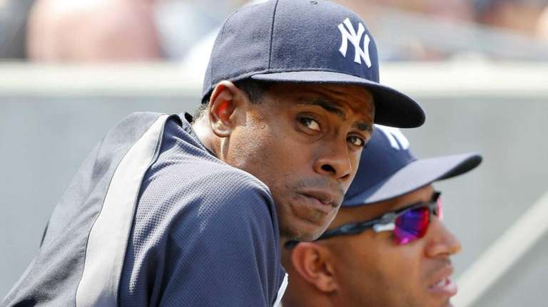 Curtis Granderson looks on during the game against