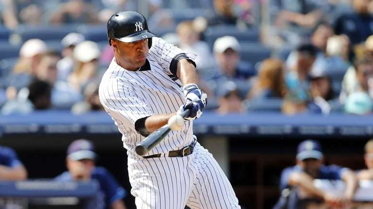 Vernon Wells of the Yankees connects on a