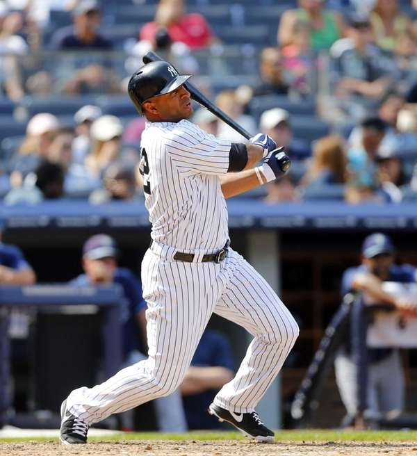 Vernon Wells of the Yankees follows through on