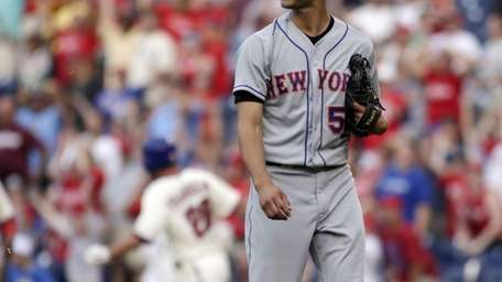 Mets pitcher Carlos Torres walks off the field