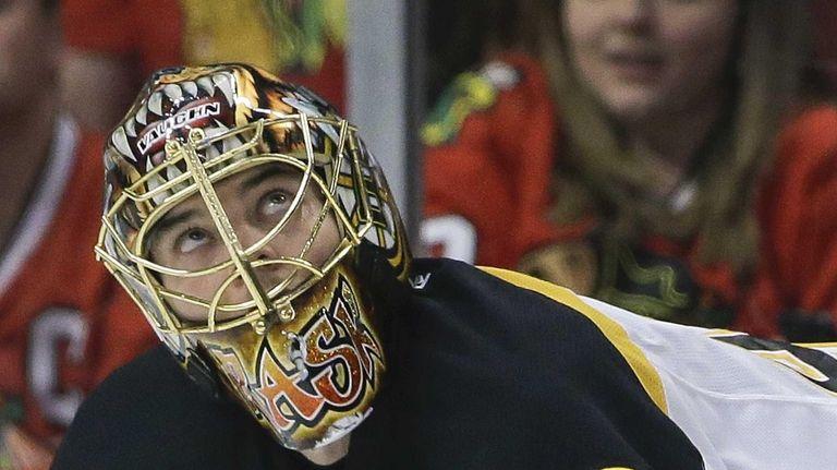 Boston Bruins goalie Tuukka Rask checks the scoreboard