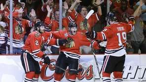 Chicago Blackhawks' Patrick Kane, center, celebrates with center