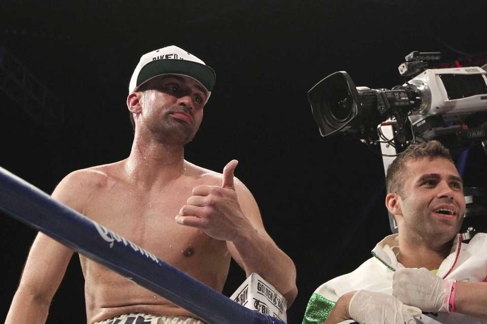Paul Malignaggi, left, reacts after losing the WBA