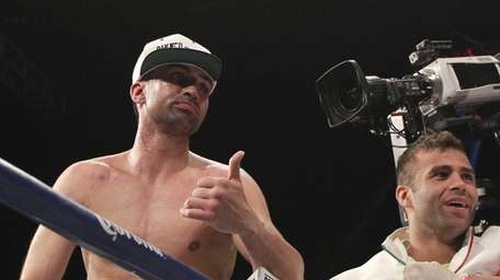 Paul Malignaggi, left, reacts after losing the WBA