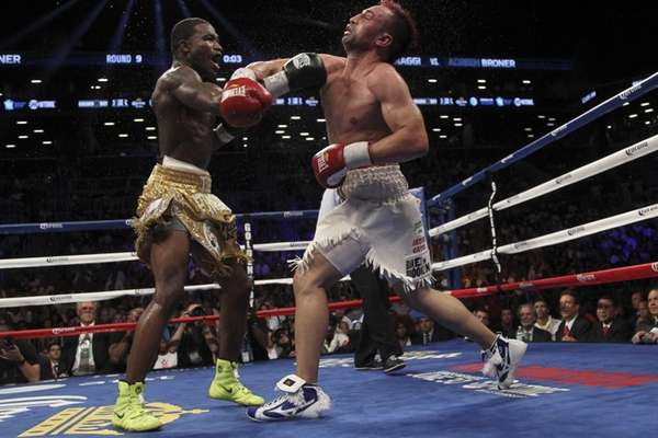 Adrien Broner, left, and Paul Malignaggi exchange punches