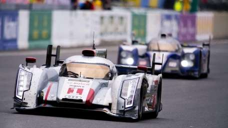 Danish driver Tom Kristensen, left, in his Audi