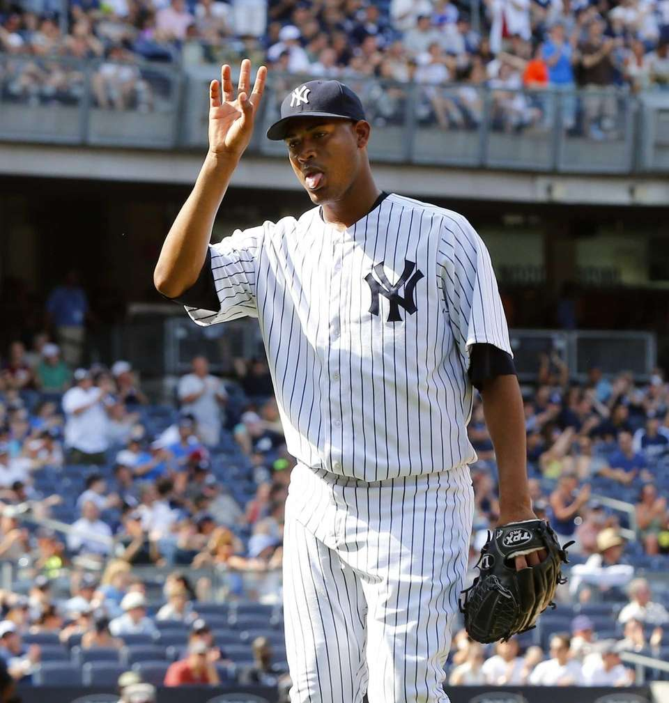 Ivan Nova of the Yankees waves as he