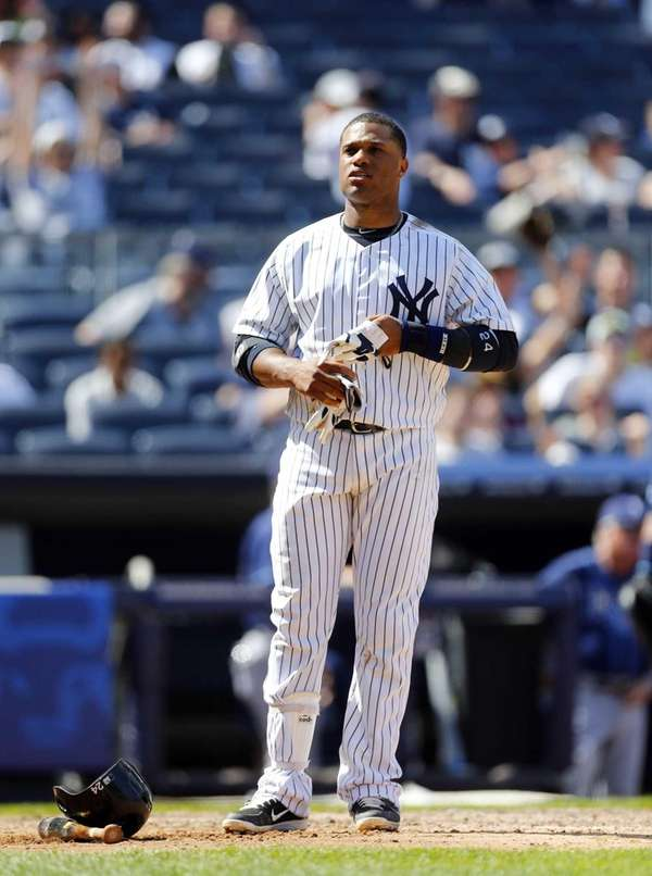 Robinson Cano of the Yankees looks on after