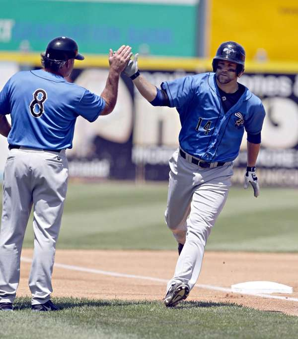 Skeeters' Reid Gorecki rounds third and is congratulated