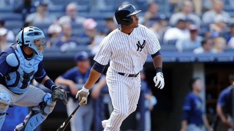 Yankees hitter Zoilo Almonte doubles during the sixth
